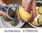 detail of woman hands peeling... | Shutterstock . vector #573983140