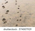Stock photo footprints in the sand sandy beach 574007929