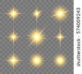 set of golden glowing star.... | Shutterstock .eps vector #574009243
