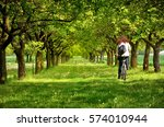 young girl on bicycle in spring ... | Shutterstock . vector #574010944
