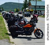 Small photo of Speculator, NY - June 7, 2015 - Large group of motorcycles parked on the street in the Adirondacks during the Americade 2015 rally.