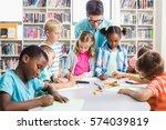 teacher helping kids with their ... | Shutterstock . vector #574039819