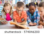 kids reading a book in library... | Shutterstock . vector #574046203