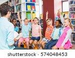 kids raising their hands in... | Shutterstock . vector #574048453