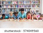 teacher and kids lying on floor ... | Shutterstock . vector #574049560