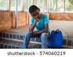 Sad Schoolboy Sitting Alone On...