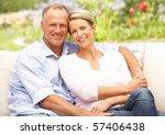 couple relaxing in garden   Shutterstock . vector #57406438