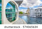 Stock photo panoramic view of berlin government district with excursion boat on spree river passing famous 574065634