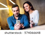 happy young couple browsing the ... | Shutterstock . vector #574066648