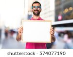 man with colorful clothes... | Shutterstock . vector #574077190