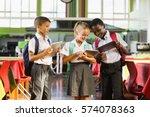 smiling school kids using... | Shutterstock . vector #574078363