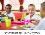 happy children having lunch...   Shutterstock . vector #574079908