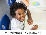 portrait of smiling schoolboy... | Shutterstock . vector #574086748