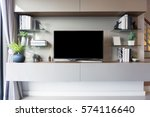 led tv on tv stand in empty... | Shutterstock . vector #574116640