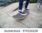 young skateboarder legs riding...   Shutterstock . vector #574126228