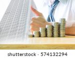 stack of coins on wooden table... | Shutterstock . vector #574132294