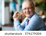 closeup of smiling middle aged... | Shutterstock . vector #574179304