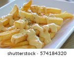 cheesy dip with french fried at ... | Shutterstock . vector #574184320