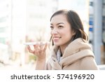 young woman talking on smart... | Shutterstock . vector #574196920