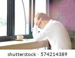 stressed man alone at the desk | Shutterstock . vector #574214389