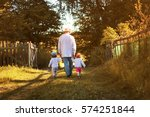 kids walk with grandfather in... | Shutterstock . vector #574251844