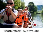young family canoeing | Shutterstock . vector #574295380