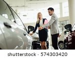salesperson selling cars at car ...   Shutterstock . vector #574303420