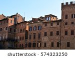 red brick buildings from siena  ... | Shutterstock . vector #574323250