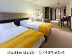 bedroom interior in hotel...   Shutterstock . vector #574345054