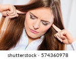 young stressed female handling... | Shutterstock . vector #574360978