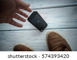 the smartphone falls between... | Shutterstock . vector #574393420