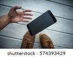 the smartphone falls between... | Shutterstock . vector #574393429