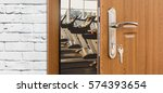 opened door to modern gym... | Shutterstock . vector #574393654