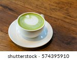 green tea and latte art heart... | Shutterstock . vector #574395910