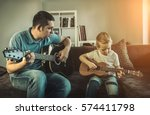 father teaching his son to play ... | Shutterstock . vector #574411798