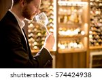 young man tasting white wine in ... | Shutterstock . vector #574424938