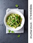 fussili pasta with basil pesto... | Shutterstock . vector #574440886