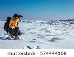 traveler man with backpack... | Shutterstock . vector #574444108