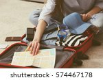 woman packing stuff into... | Shutterstock . vector #574467178