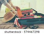 woman packing stuff into... | Shutterstock . vector #574467298