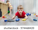 little boy plays with toy car... | Shutterstock . vector #574468420