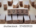 rules word in wooden cube | Shutterstock . vector #574505923