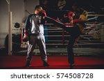 woman kick box  training kicks... | Shutterstock . vector #574508728