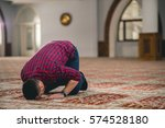muslim praying  prostrating on... | Shutterstock . vector #574528180