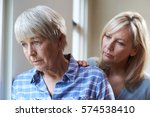 serious senior woman with adult ... | Shutterstock . vector #574538410