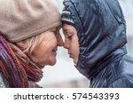 grandmother comforts her... | Shutterstock . vector #574543393