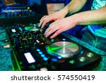 hands of a dj at a mixer for... | Shutterstock . vector #574550419