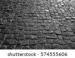 black cobbled stone road... | Shutterstock . vector #574555606