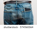 closeup to back of man  jeans...   Shutterstock . vector #574560364