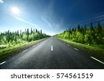 road in forest  sweden | Shutterstock . vector #574561519